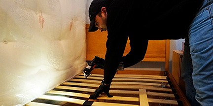 Technician inspects for bed bugs